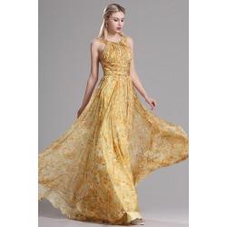 Letní nádherné dlouhé společenské žluté šaty s potiskem květů a sexy holými zády