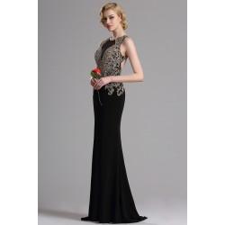 Překrásné a velice elegantní dlouhé černé šaty s plně do zlata kamínky zdobeným topem a svůdným výstřihem na zádech